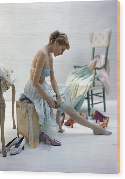 A Woman Putting On Her Stockings Wood Print