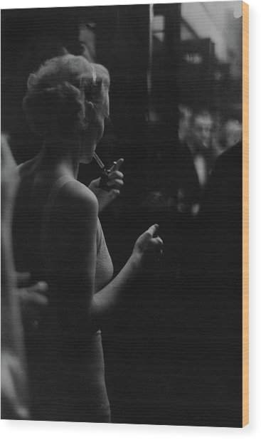 A Woman Smoking At The Music Box Wood Print
