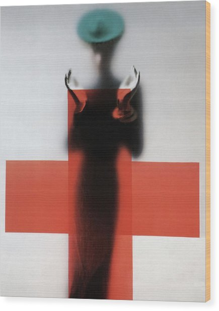 A Woman Standing Behind A Red Cross On Frosted Wood Print