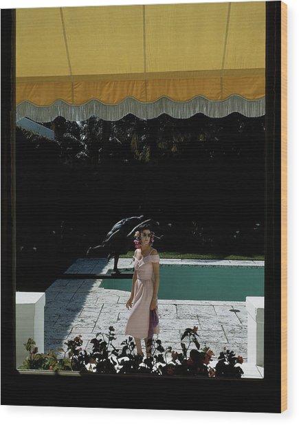 A Woman Walking Beside Her Swimming Pool Wood Print by John Rawlings