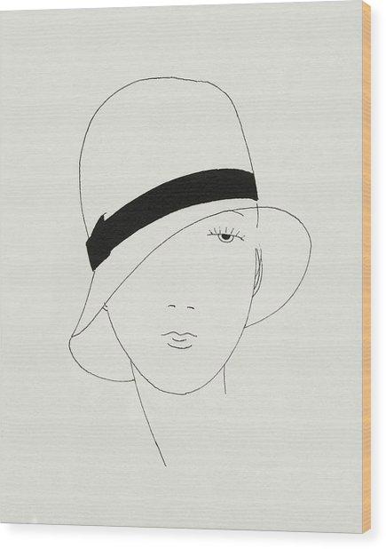 A Woman Wearing A Hat Wood Print