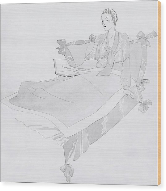 A Women Sitting In Bed With A Book Wood Print