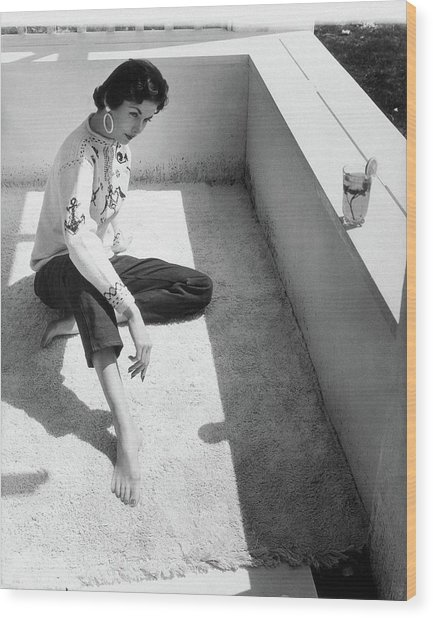 A Young Model Crouching On A Porch Wood Print