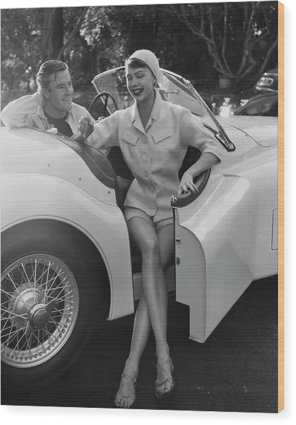 A Young Model Sitting In A Convertible Sports Car Wood Print