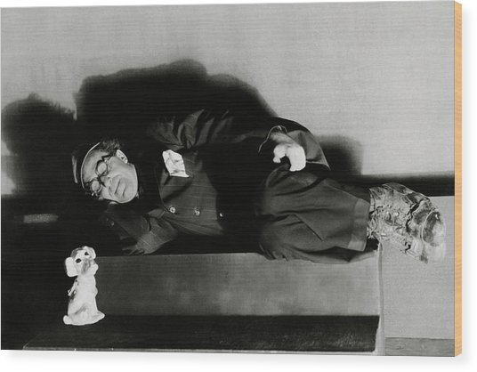 Actor Ed Wynn Lying Down On A Bench In 'the Laugh Wood Print by Florence Vandamm