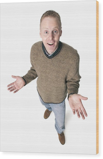 Adult Caucasian Man Dressed In Jeans And Green Sweater Gestures With His Hands Shrugs His Shoulders Wood Print by Photodisc