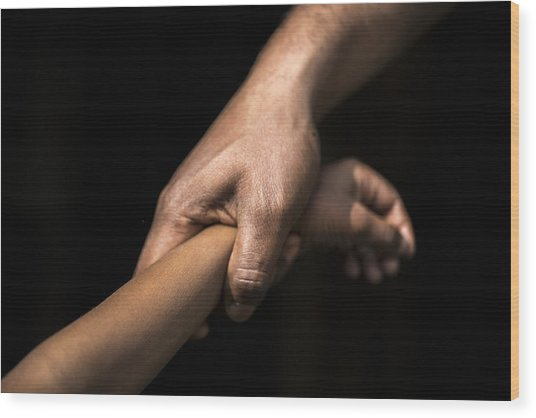 Adult Holding A Child's Wrist Wood Print by James Morgan