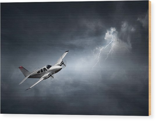 Risk - Aeroplane In Thunderstorm Wood Print