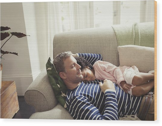 Affectionate, Serene Multi-ethnic Father And Daughter Napping On Sofa Wood Print by Caiaimage/Paul Bradbury