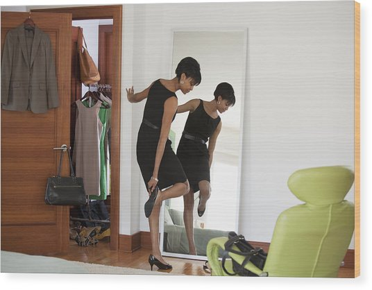 African American Woman Dressing In Bedroom Wood Print by Ariel Skelley