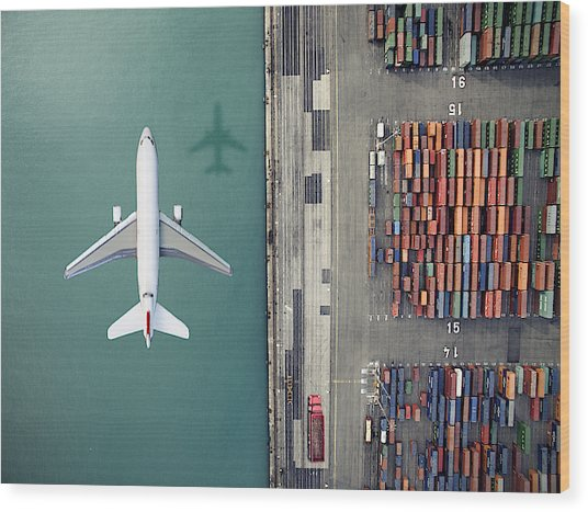 Airplane Flying Over Container Port Wood Print by Orbon Alija