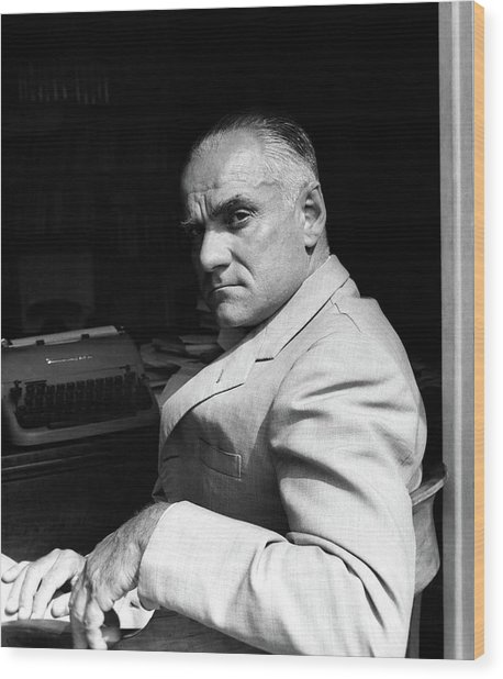 Alberto Moravia Sitting At His Desk Wood Print