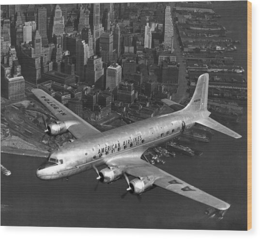 American Dc-6 Flying Over Nyc Wood Print