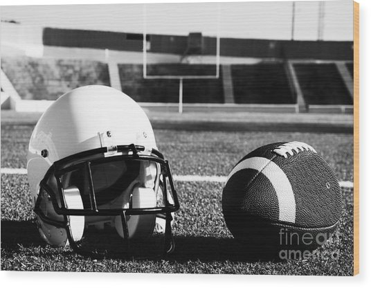 American Football And Helmet On Field Wood Print
