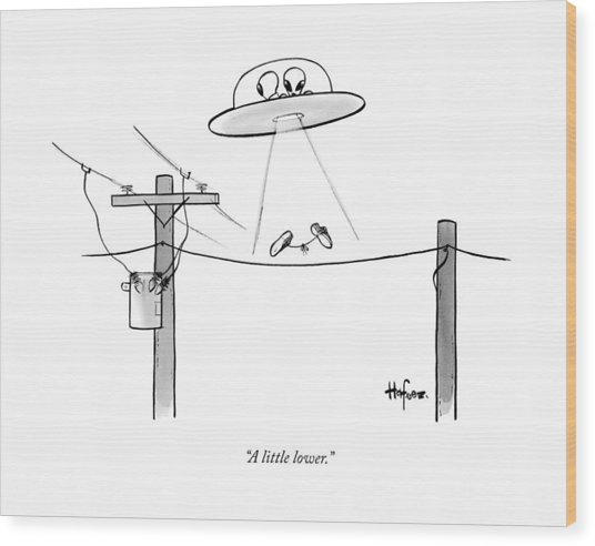 An Alien Space Craft Lowers Two Sneakers Tied Wood Print