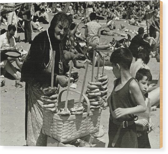 An Elderly Woman Selling Food On The Beach Wood Print