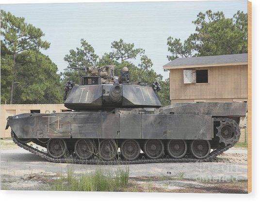 An M1a1 Abrams Tank Takes A Defensive Wood Print