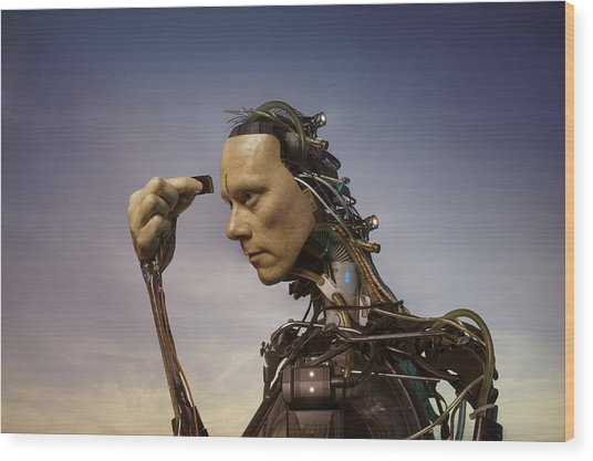 Android Robot Replacing Memory Card Wood Print by Peter Sherrard