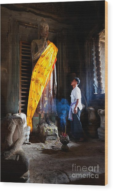 Angkor Wat Devotee Lights Incense In Buddha Temple Wood Print