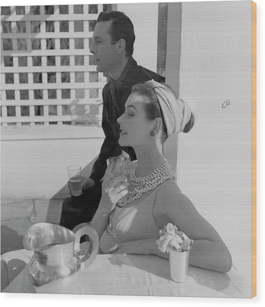 Anne Gunning Parker Sitting With A Man Wood Print by Horst P. Horst