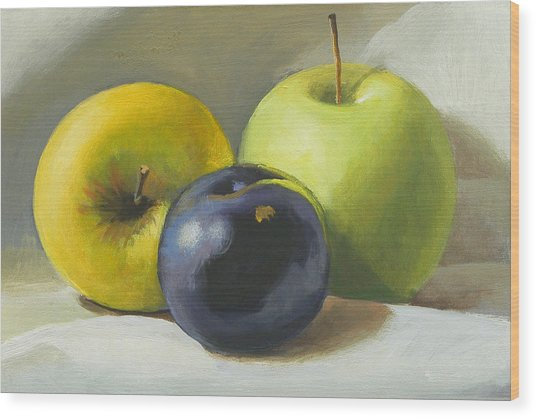 Apples And Plum Wood Print by Peter Orrock