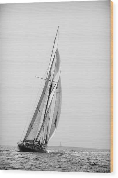 A Tall Ship In Mediterranean Water Approaching To Lighthouse Of Isla Del Aire - Menorca Wood Print