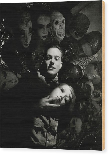 Artist Oliver Messel Surrounded By Various Masks Wood Print
