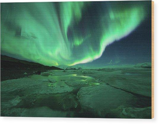 Aurora Display Over The Glacier Lagoon Wood Print by Natthawat