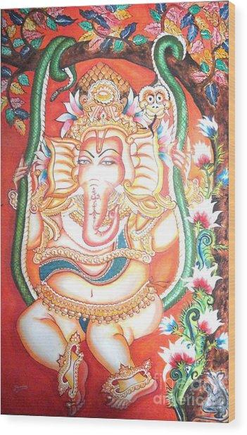 Baby Ganesha Swinging On A Snake Wood Print by Jayashree