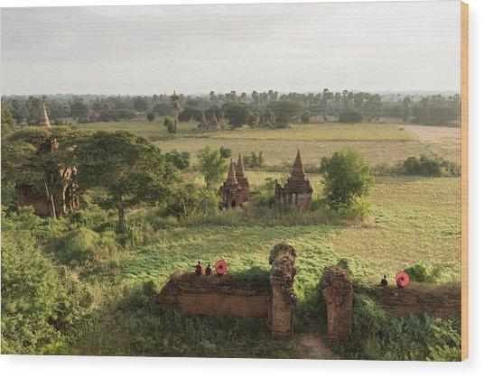 Bagan, Buddhist Monks Sitting Amongst Wood Print by Martin Puddy