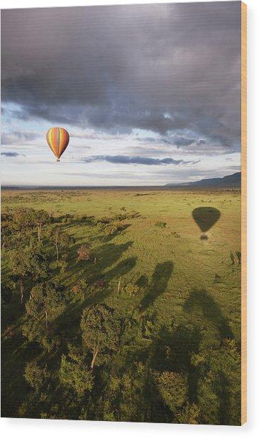 Balloon In Masai Mara National Park Wood Print by Luis Davilla