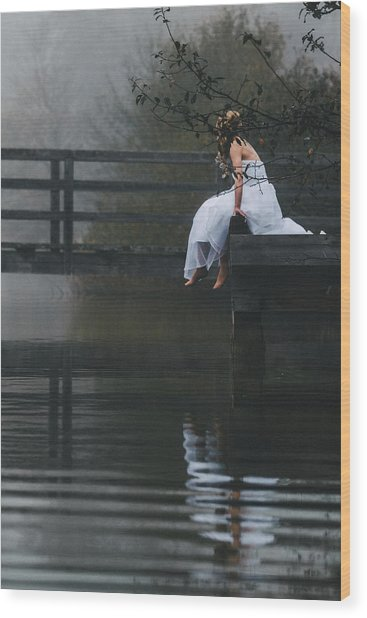 Barefoot Bride In White Wedding Dress Sitting On A Jetty At A La Wood Print by Leander Nardin