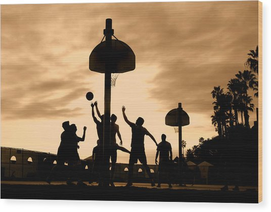 Basketball Players At Sunset Wood Print