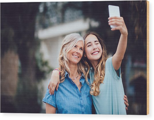 Beautiful Mature Mother And Adult Daughter Taking Selfies Together Wood Print by Wundervisuals