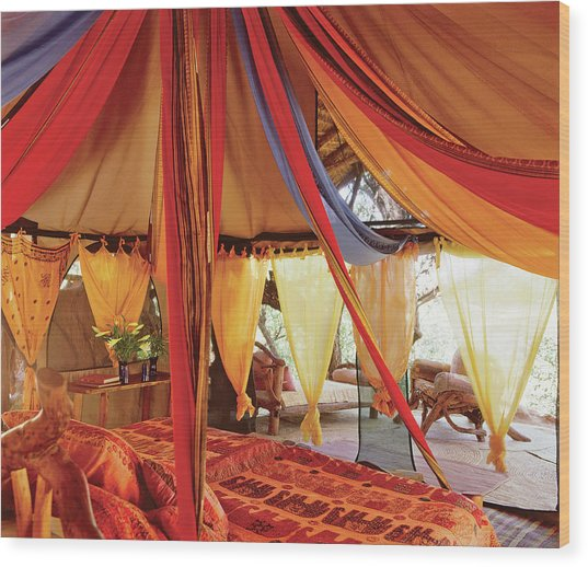 Bedroom With Multi Coloured Bed Canopy Wood Print