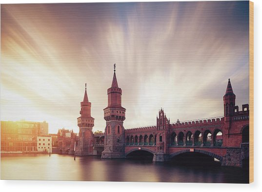 Berlin Oberbaum Bridge With Dramatic Sky Wood Print by Spreephoto.de