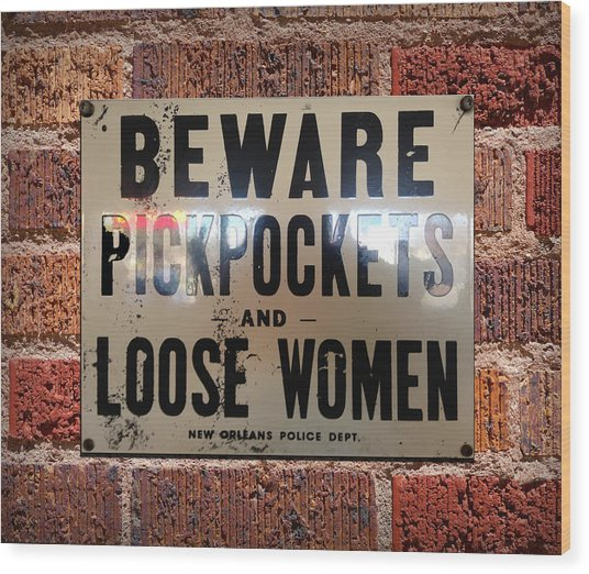 Beware Pickpockets And Loose Women Sign On Brick Wall Wood Print