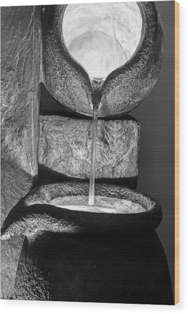 Black And White Water Pouring Forth From Large Stone Pots Wood Print