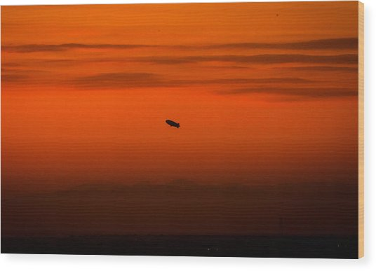 Blimp At Dusk Wood Print