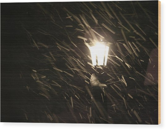 Blowing Snow Against Lamp Wood Print by Carolyn Reinhart