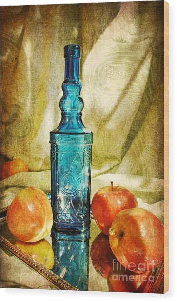 Blue Bottle With Apples Wood Print