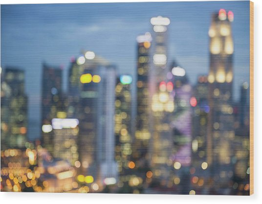 Blurred View Of City Skyline Lit Up At Wood Print by Jacobs Stock Photography Ltd