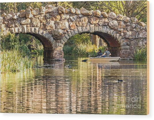 Boaters Under The Bridge Wood Print