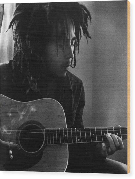 Bob Marley Leaning Over Guitar Wood Print