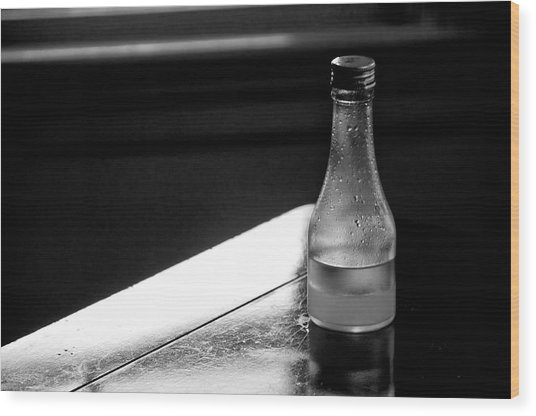 Bottle Near Window Wood Print by Guillermo Hakim