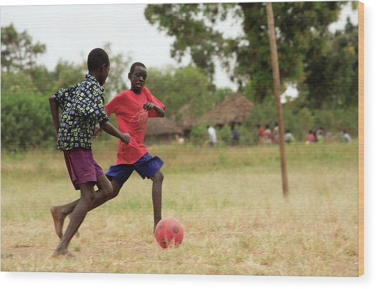 Boys Playing Football Wood Print by Mauro Fermariello/science Photo Library