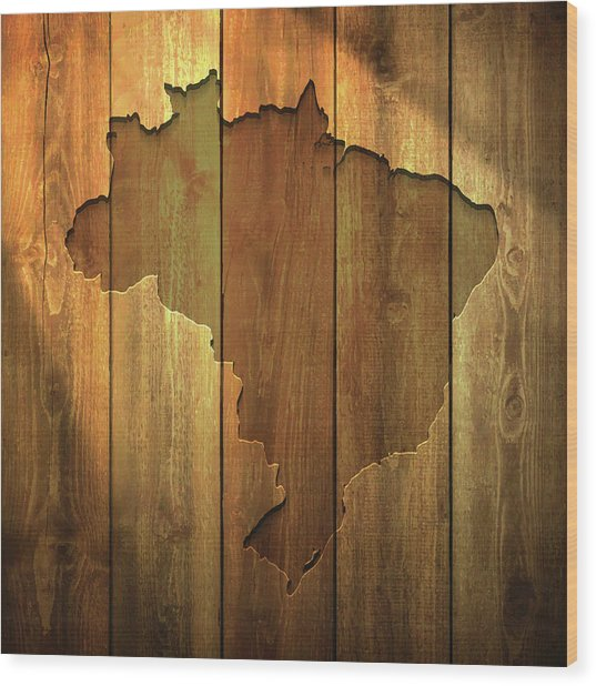 Brazil Map On Lit Wooden Background Wood Print by Bgblue