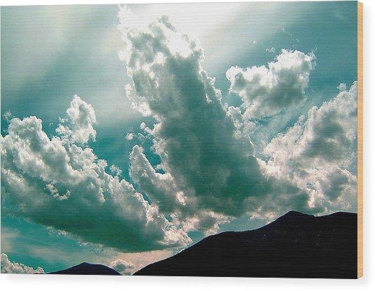 Bright Clouds Wood Print by Mavis Reid Nugent