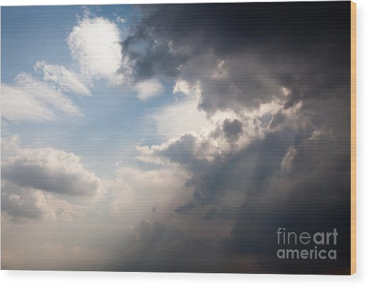 Broken Rain Clouds With Blue Sky And Sun Streaming Through Cloud Wood Print