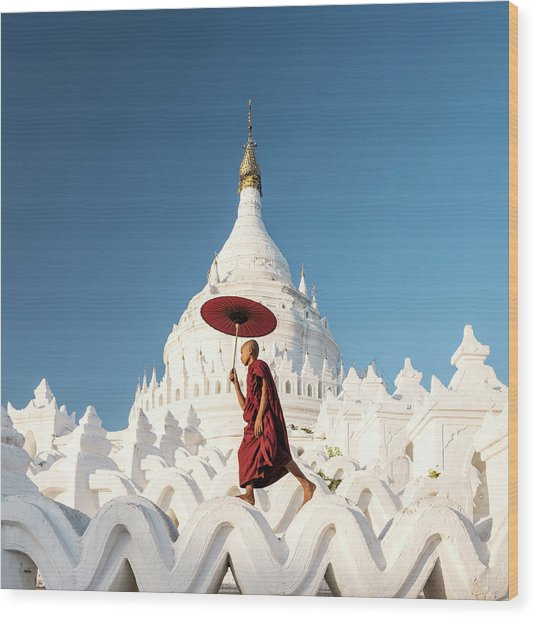 Buddhist Monk Walking Across Arches Of Wood Print by Martin Puddy